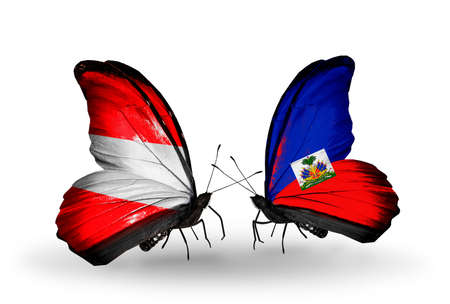 Two butterflies with flags on wings as symbol of relations Austria and Haiti photo