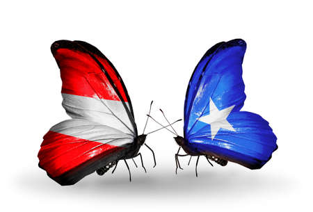 Two butterflies with flags on wings as symbol of relations Austria and Somalia photo