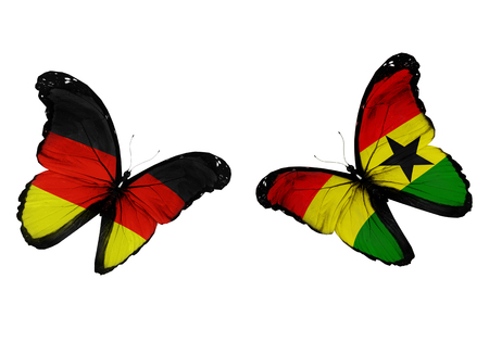 penalty flag: Concept - two butterflies with Germany and Ghana flags flying, like two football teams playing Stock Photo