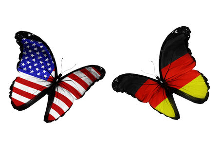 penalty flag: two butterflies with USA and Germany flags flying Stock Photo