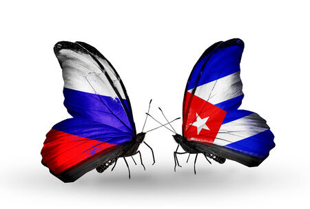 Two butterflies with flags on wings as symbol of relations Russia and Cuba