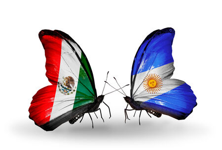 Two butterflies with flags on wings as symbol of relations Mexico and Argentina photo