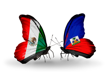 Two butterflies with flags on wings as symbol of relations Mexico and Haiti photo