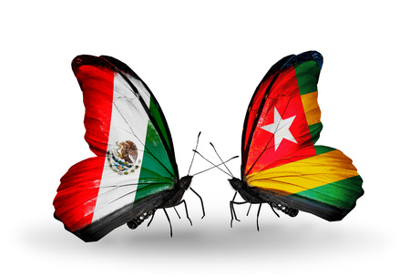 Two butterflies with flags on wings as symbol of relations Mexico and  Togo photo