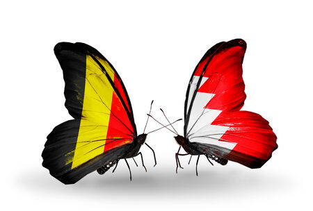 bahrain money: Two butterflies with flags on wings as symbol of relations Belgium and Bahrain