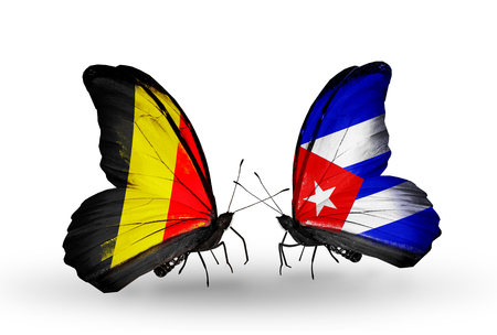 Two butterflies with flags on wings as symbol of relations Belgium and Cuba