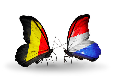 Two butterflies with flags on wings as symbol of relations Belgium and Luxembourg photo