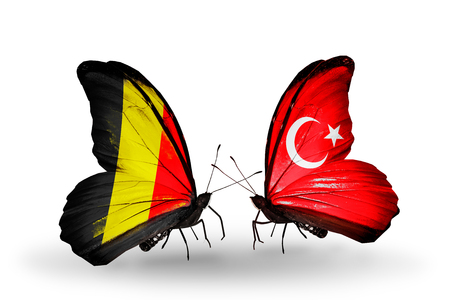 Two butterflies with flags on wings as symbol of relations Belgium and  Turkey photo