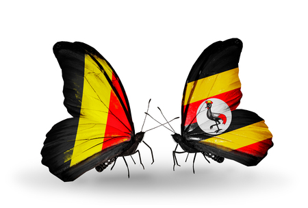 Two butterflies with flags on wings as symbol of relations Belgium and Uganda photo