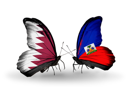 Two butterflies with flags on wings as symbol of relations Qatar and Haiti photo