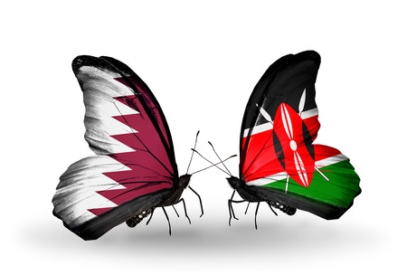 Two butterflies with flags on wings as symbol of relations Qatar and Kenya photo