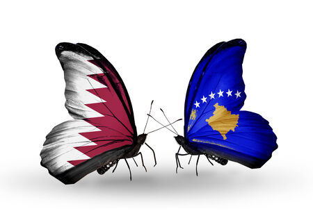 Two butterflies with flags on wings as symbol of relations Qatar and Kosovo photo