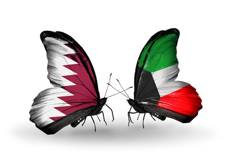Two butterflies with flags on wings as symbol of relations Qatar and Kuwait photo