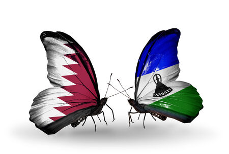 Two butterflies with flags on wings as symbol of relations Qatar and Lesotho photo