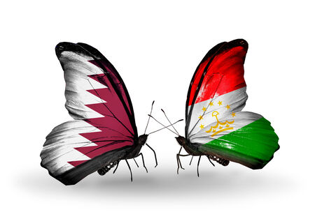 economy of tajikistan: Two butterflies with flags on wings as symbol of relations Qatar and Tajikistan Stock Photo