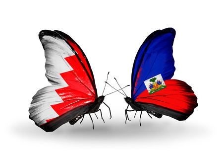 Two butterflies with flags on wings as symbol of relations Bahrain and Haiti photo