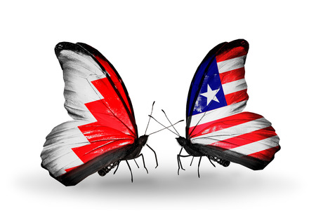 Two butterflies with flags on wings as symbol of relations Bahrain and Liberia photo