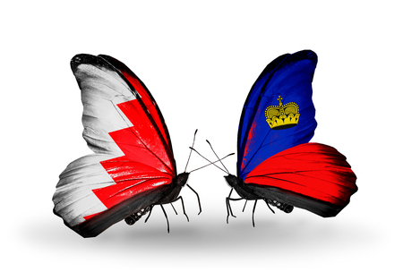 Two butterflies with flags on wings as symbol of relations Bahrain and  Liechtenstein photo