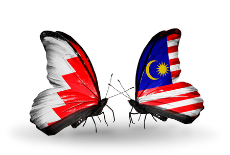 Two butterflies with flags on wings as symbol of relations Bahrain and  Malaysia photo