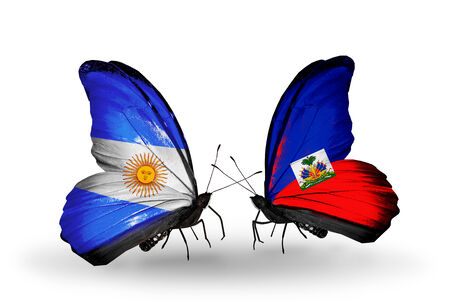 Two butterflies with flags on wings as symbol of relations Argentina and  Haiti photo