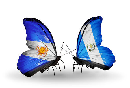Two butterflies with flags on wings as symbol of relations Argentina and Guatemala photo