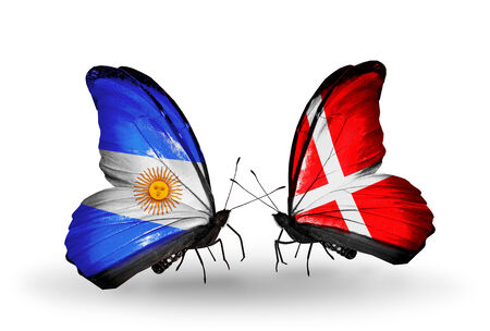 Two butterflies with flags on wings as symbol of relations Argentina and Denmark photo