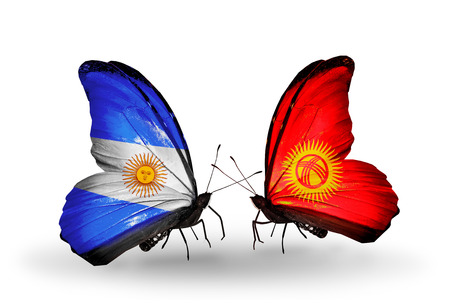 Two butterflies with flags on wings as symbol of relations Argentina and Kirghiz photo