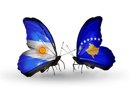 Two butterflies with flags on wings as symbol of relations Argentina and Kosovo photo