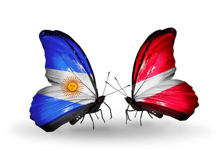 Two butterflies with flags on wings as symbol of relations Argentina and  Latvia photo