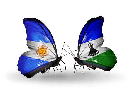 Two butterflies with flags on wings as symbol of relations Argentina and Lesotho photo