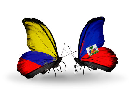 Two butterflies with flags on wings as symbol of relations Columbia and Haiti photo