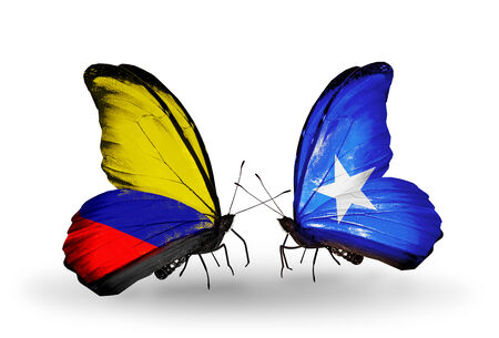 Two butterflies with flags on wings as symbol of relations Columbia and Somalia photo