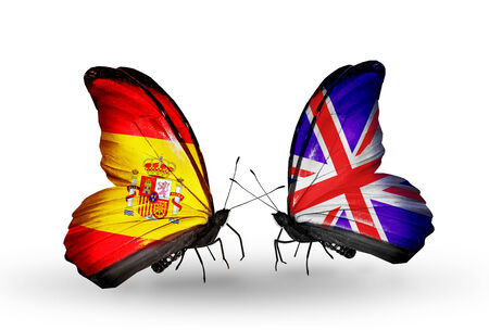 Two butterflies with flags on wings as symbol of relations Spain and UK photo