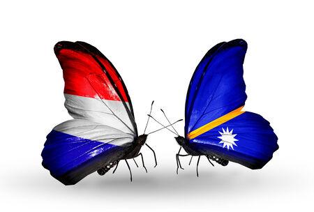 nauru: Two butterflies with flags on wings as symbol of relations Holland and Nauru