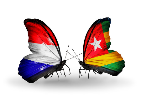 Two butterflies with flags on wings as symbol of relations Holland and Togo photo