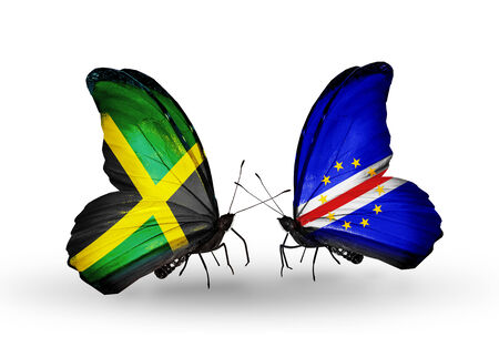 cape verde flag: Two butterflies with flags on wings as symbol of relations Jamaica and Cape Verde Stock Photo