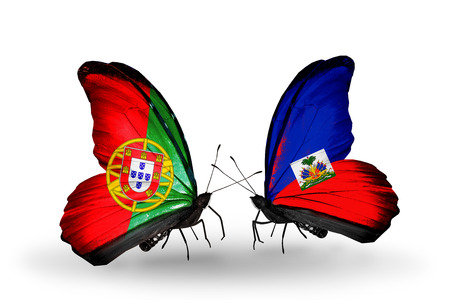 Two butterflies with flags on wings as symbol of relations Portugal and Haiti photo