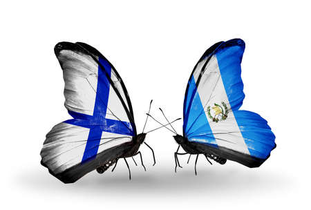 Two butterflies with flags on wings as symbol of relations Finland and  Guatemala photo