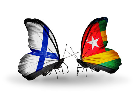 Two butterflies with flags on wings as symbol of relations Finland and Togo photo