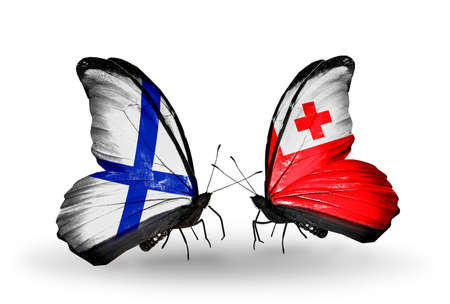 Two butterflies with flags on wings as symbol of relations Finland and Tonga Stock Photo