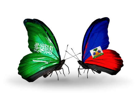 Two butterflies with flags on wings as symbol of relations Saudi Arabia and Haiti photo