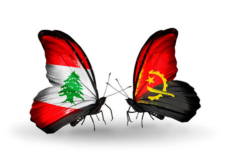 Two butterflies with flags on wings as symbol of relations Lebanon and Angola photo