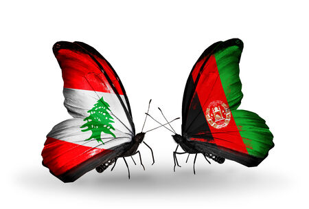 Two butterflies with flags on wings as symbol of relations Lebanon and Afghanistan photo