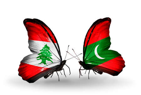 Two butterflies with flags on wings as symbol of relations Lebanon and Maldives photo
