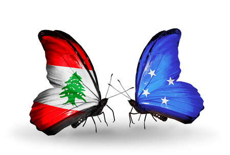 Two butterflies with flags on wings as symbol of relations Lebanon and Micronesia photo