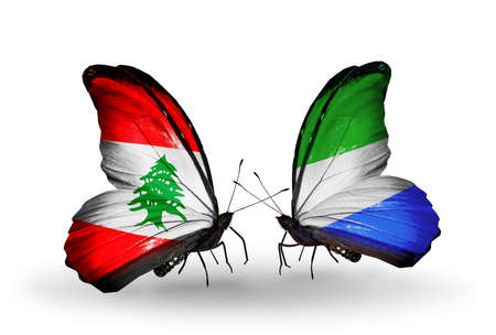 Two butterflies with flags on wings as symbol of relations Lebanon and Sierra Leone photo