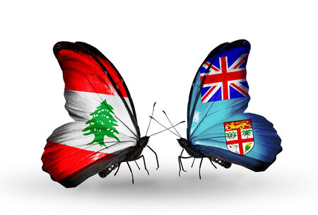 Two butterflies with flags on wings as symbol of relations Lebanon and Fiji photo