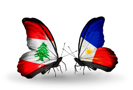 Two butterflies with flags on wings as symbol of relations Lebanon and Philippines photo