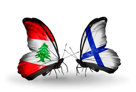 Two butterflies with flags on wings as symbol of relations Lebanon and Finland photo