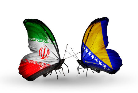 Two butterflies with flags on wings as symbol of relations Iran and Bosnia and Herzegovina photo